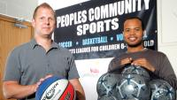 Willie Brown (left) and Kirk Rookwood show off some of the basketballs and soccer balls donated to Peoples Community Sports by Sport Chek, which will be given to kids who sign up for the free sports leagues offered by Peoples Church on the west Mountain.