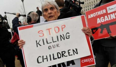 a-protester-demonstrates-in-front-of-the-nra-lobbying-offices-in-washington-dc-on-dec-17.jpg